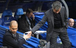Guardiola and Mourinho doing that convincing handshake thing that they do so well