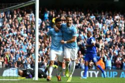 Alguero (L) and Negredo celebrate Man City's third goal, the result of a controversial penalty