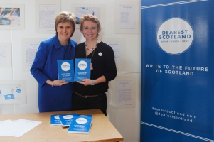 Cat presents the First Minister Nicola Sturgeon with her own Dearest Scotland book copy