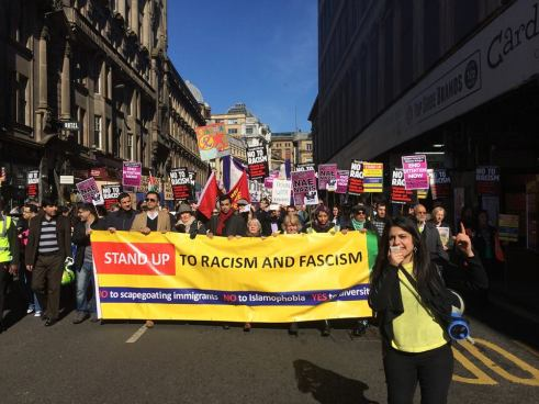 Up front: Roza Salih leads the ralliers down Glasgow's Union Street during the Stand Up to Racism and Fascism demonstration in March 2015