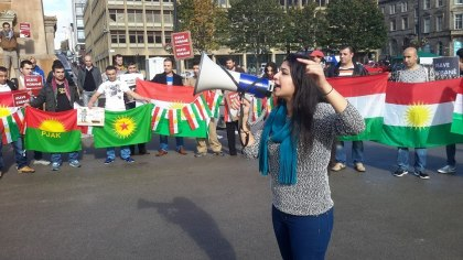 Roza speaking out about the political and social issues in her Kurdish homeland in Glasgow's George Square